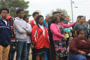 Ms. Kegi Wells, Principal of MSPHS, and students at the unveiling